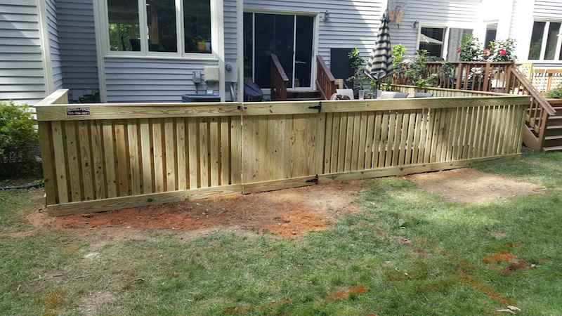 How Wood Fence Installation Fixes Property Deficits
