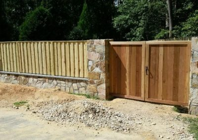 Custom Enclosure Board on Batten Fence with Solid Board Gate